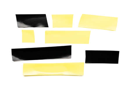 Tape roll. Adhesive paper or yellow and black sticky piece isolated on white background. Torn strip grunge texture.