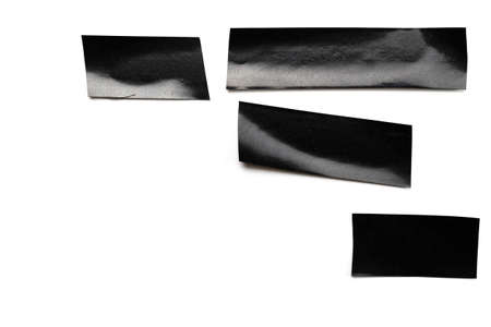 Paper adhesive background. Piece of black sticky strip tape isolated on white. Torn grunge texture