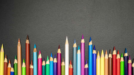 Blackboard background. Education accessories with colorful pencils, chalk, brushes on dark school blackboard. Design Copy Space Supplies. Top View, Flat Lay. Stock Photo