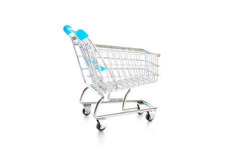 Products cart. Food shopping basket for retail market. Empty trolley cart for supermarket isolated on white background. Creative idea for shopping online, summer sale, supermarket