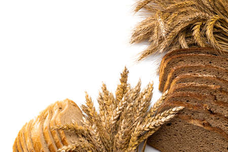Home baked bread. Rye bakery with crusty loaves and crumbs. Fresh rustic traditional bread with wheat grain ear or spike plant isolated on white background. Design element for bakery product label
