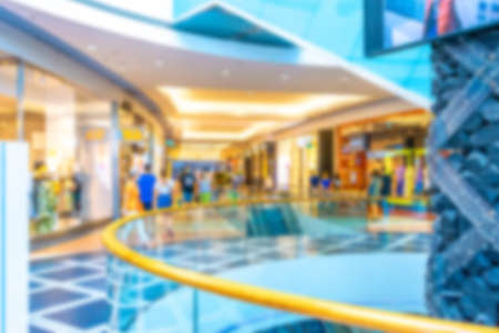 Shopping supermarket blurred background. Interior of retail center store in soft focus. People shopping in modern commercial mall center. Fashion market hall
