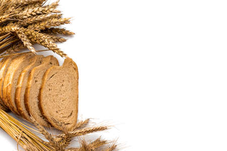 Freshly baked bread. Fresh loaf of rustic traditional bread with wheat grain ear or spike plant isolated on white background. Rye bakery with crusty loaves and crumbs. Healthy food concept
