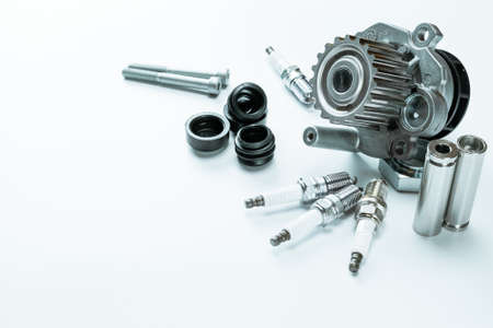 Sapre parts. Auto motor mechanic spare or automotive piece on white background. Set of new metal car part. Automobile engine service