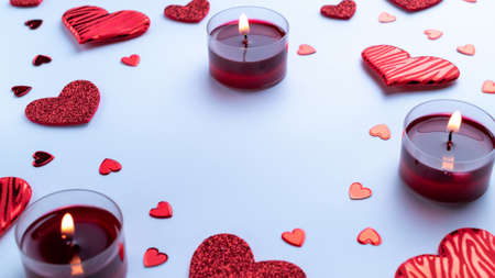 Happy days background. Red love hearts, romantic gift box, Valentines day candle on white table. Romantic message template with copy space