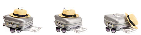 Baggage isolated. Travel accessories set with suitcase, straw hat and toy airplane in minimal trip vacation concept isolated on white background. Summer vacation and product advertisement concept