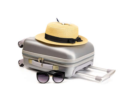 Bag travel. Suitcase, sunglasses with toy plane and straw hat in travel composition isolated on white background. Copy space of summer vacation and business travel concept