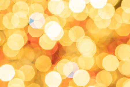 White gold abstract lights. Festive glitter blur Bokeh background. Defocused winter backdrop