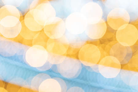 Gold black abstract light bokeh. Festive glitter blur background. Christmas and New Year holidays backdrop