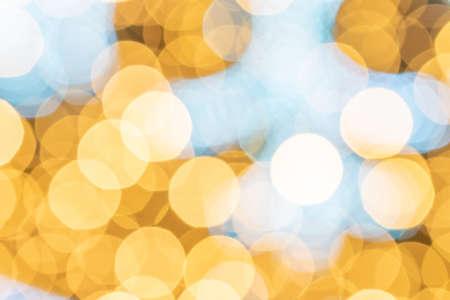 Festive background gold. abstract glitter bokeh blur lights. Defocused winter backdrop Фото со стока
