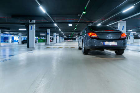 Parking lot. Car lot parking space in underground city garage. Empty road asphalt background. Ground floor for car parking Banque d'images