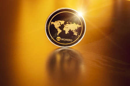 Monero icon. Gold Crypto currency BTC Bitcoin on black background. Golden Bit Coin virtual cryptocurrency or blockchain technology. Trading on the cryptocurrency exchange 免版税图像