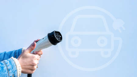 Electric car charge. Power cable pump plug in eco green energy hybrid vehicle on future charger station. Recharge fuel technology with cable to power battery. Eco-friendly sustainable energy concept 免版税图像