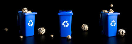 Trash recycle collection. Bin container for disposal garbage waste and save environment. Blue dustbin for recycle plastic, paper and glass can trash isolated on black background 免版税图像