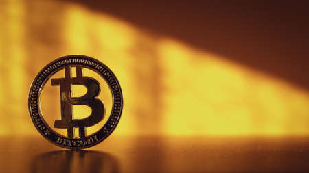 Trade bitcoin. Golden Bit Coin virtual cryptocurrency or blockchain technology. Gold Crypto currency BTC Bitcoin on black background. Block chain, network connect concept 免版税图像
