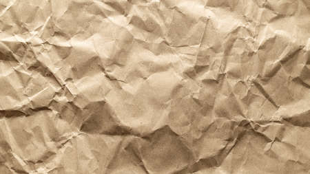 Torn craft. Kraft paper texture background. Old craft vintage cardboard isolated on black. For designs, decoration and nature background concept