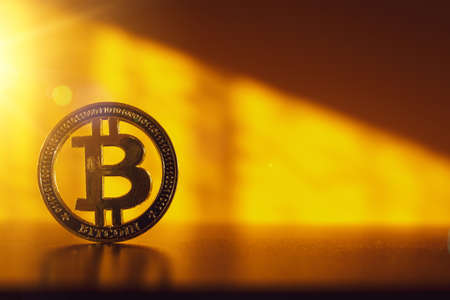 Bitcoin wallet. Golden Bit Coin virtual cryptocurrency or blockchain technology. Gold Crypto currency BTC Bitcoin on black background. Investing in virtual assets, bull market trend concept