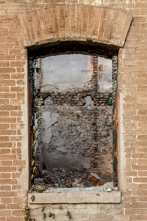 windows frame: Window with fragment of ruined back wall in old abandoned brick building