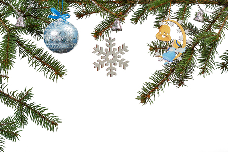 Branches of fir tree with toy ball, bells and other Christmas ornament on white isolated