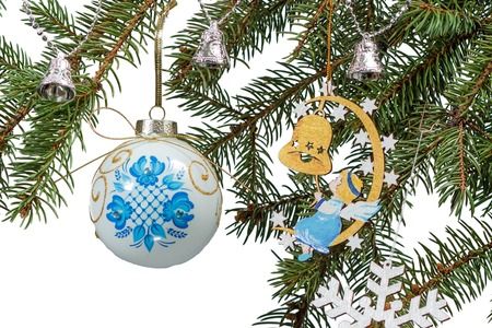 Branches of fir tree with toy ball, bell and other Christmas ornament on white isolated Foto de archivo