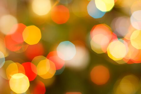 Christmas blurred background with red and yellow festive lights. Abstract circular bokeh background. Banque d'images