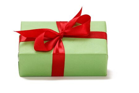 Gift box tied with red ribbon on white isolated background. Greeting card concept.