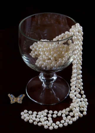 A wine glass with pearl decoration Stock Photo