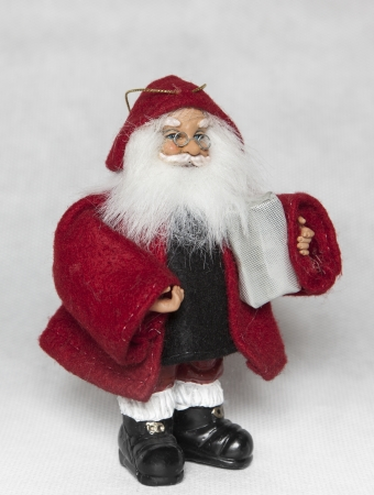 Santa Claus with red had and a gift Stock Photo