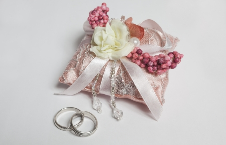 Two silver rings and small decoration pillow with rose photo