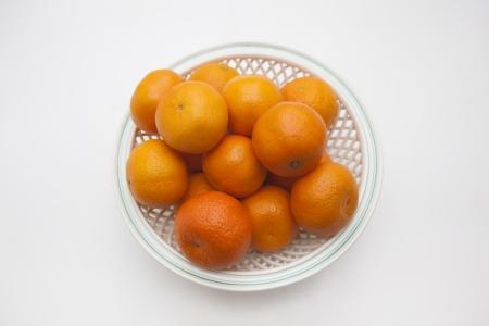 Mandarins on white plate in white background