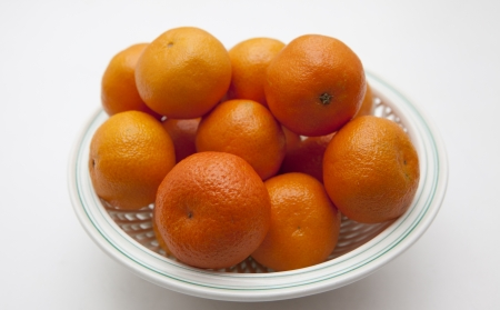 Mandarins on white plate in white background