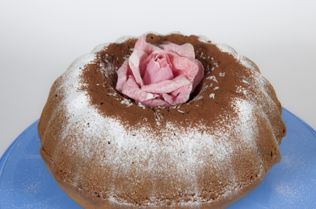 A cake with rose and cocoa