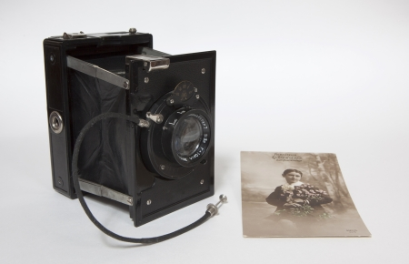 folding camera: An antique old camera with an old picture