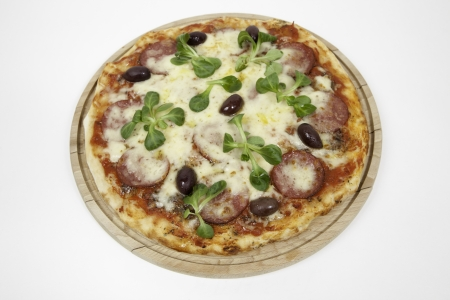 A pizza on a wooden plate