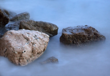 There are some rocks in the sea