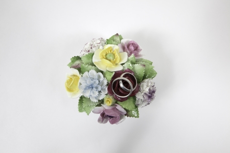 Two silver rings and flowers