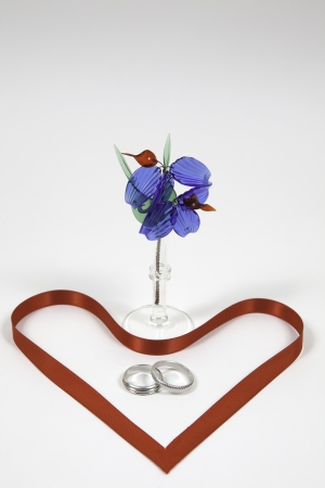 Two silver rings with red ribbon Stock Photo