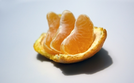 Pieces of mandarin on white background