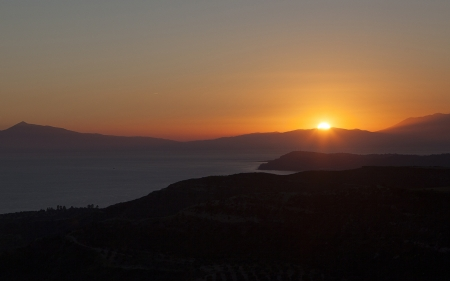 Sunset at the aegean sea and mountains Stock Photo
