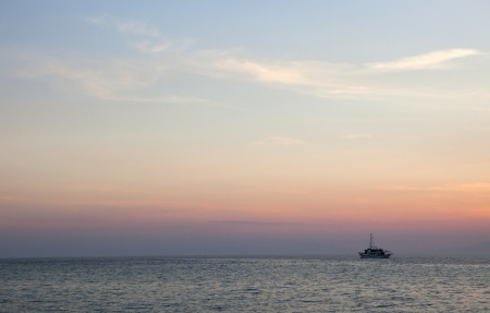 A boat at sunset in aegean sea