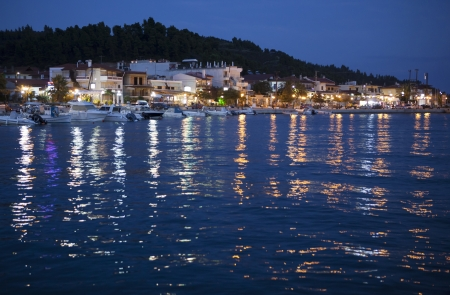 A tourists village at night in Aegean sea photo