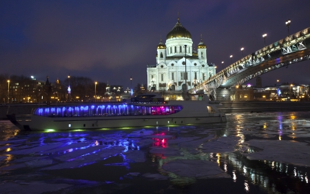 Russian orthodox cathedral church frozen river and boat photo