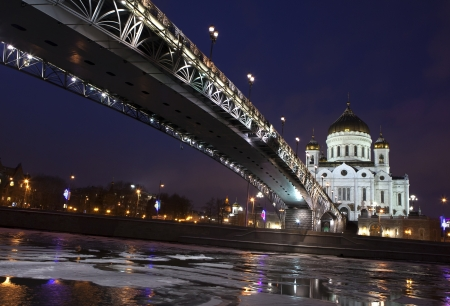Russian orthodox cathedral church frozen river at the night photo