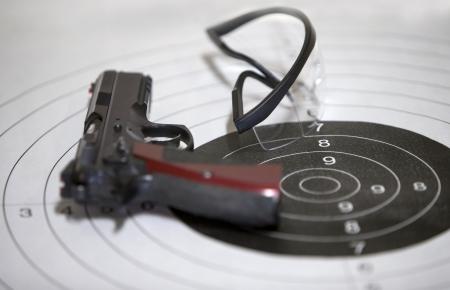 semi automatic: Guns glasses target in a shooting range