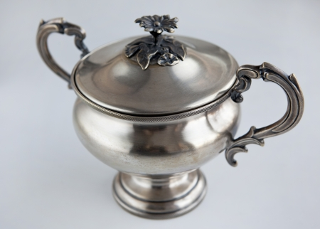 A silver antique vintage amphora vase