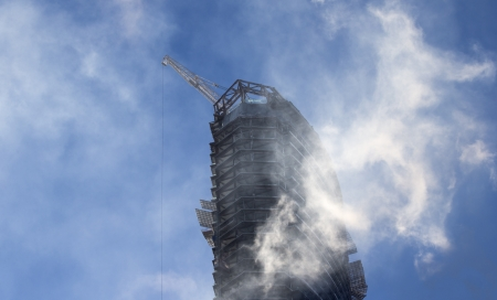 A building under construction with blue sky on background Stock Photo
