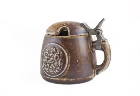 An old antique mustard pot