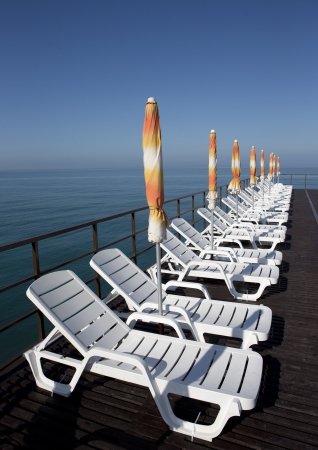 Sun beds seen at a beach in the Black sea in Sochi photo