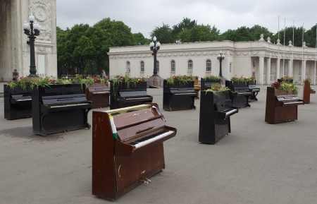 Old antique pianos displayed in front of a park in Moscow