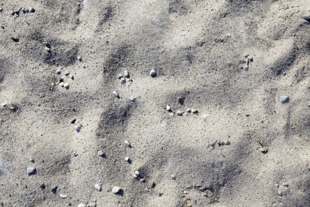 Sand and gravel in a beach Stock Photo